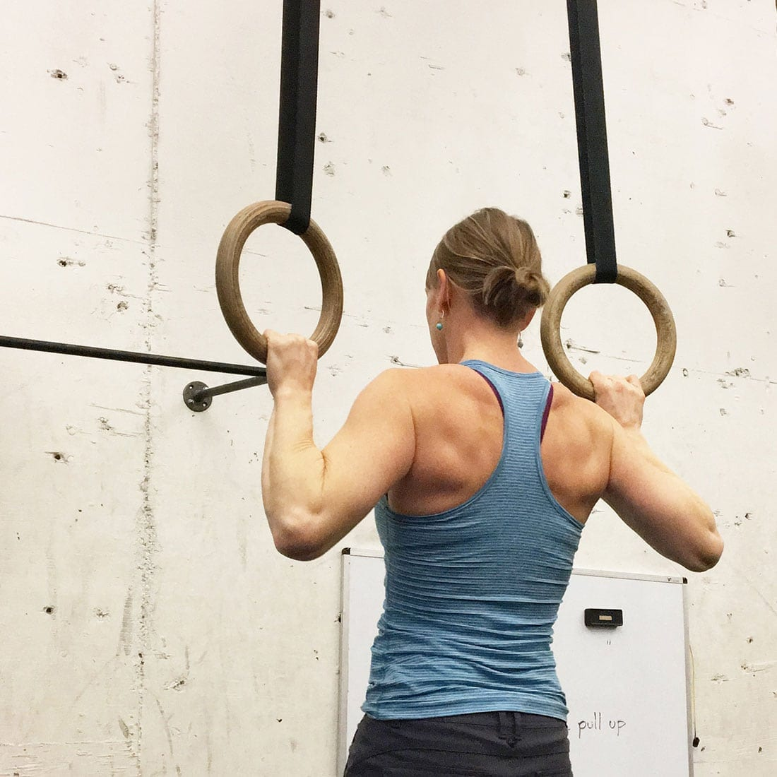 woman working out with gym rings