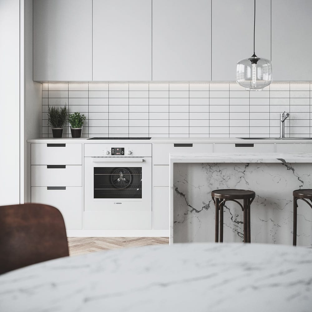 white kitchen with marble table and island