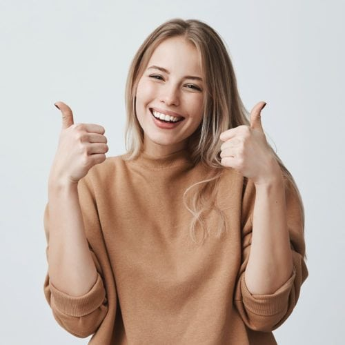 women excited thumbs up