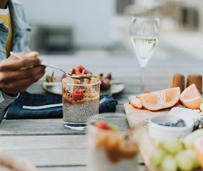 couple enjoying healthy food outdoors